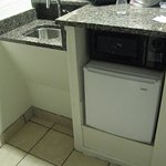 Tiny fridge and microwave under counter
