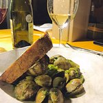 Manilla clams, Vermouth, arugula Pistou and garlic toast