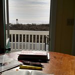 Looking from the kitchen table past the balcony to the ocean.