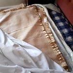 Old blanket padding in mattress