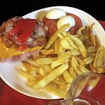 Full Hamburger with cheese, ham, bacon, roasted red pepper, boiled eggs, tomatoes and hand cut f