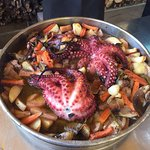 Octopus prepared on the open fireplace (close look).