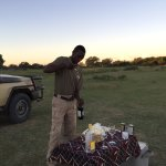 Our guide's aide Albert serving us snacks and our favorite drink just before sunset