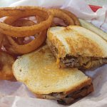 He Who Melt It sandwich with onion rings