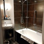 Big enough bathroom, well lit, with decent shower pressure in the over the bath shower.
