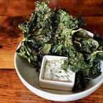 kale chips with sumac, sesame, and cucumber yogurt