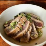 Seared tuna with wakame salad, sesame and lemongrass vinaigrette, scallions, and chili oil