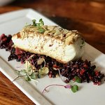 pan-seared halibut with almond and brown butter crust on a bed of chilled forbidden rice salad
