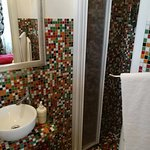 Shower and adjustable towel rack.