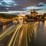 Notre Dame and River boat traces from the Pont de la Tournelle on Paris