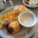 Cheese & ham omelet, hash brown casserole, biscuit and peppery gravy