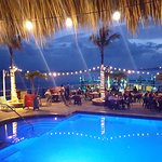 Pool, dining and bar area at dusk. . just beautiful!