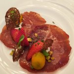 The first course, Imported bresaola, coastal strawberry, sun gold tomato, sorrel