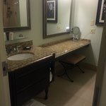 Extra long vanity next to single sink, lovely granite counter tops