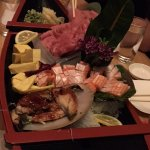 Chef's boat of sashimi and sushi