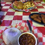 Pulled pork, slaw, beans, hush puppies, fish sandwich, and fries.