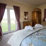 Wake up to the sunrise in Redwheel's master bedroom with it's 6ft bed. All ground floor accommod