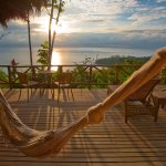 Enjoy an unforgettable sunrise from your private hammock