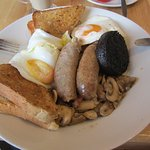 REALLY TASTY, OPTIONAL BLACK PUDDING BACON BENNEATH NO BEANS ,SAUSAGES A LITTLE UNDER DONE