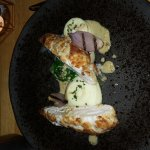 Chicken breast with chive mash, mustard sauce,  spinach and onion.