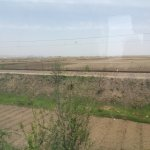 View from train in DPRK with Dandong in the distance