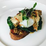 sous vid egg on grilled local toast with romanesco, greens, mustard