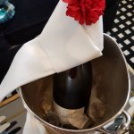 Welcoming Champagne with Signature Red Carnation
