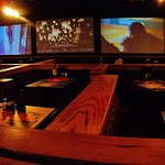 booths and big screens on far wall
