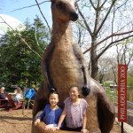 our daughters standing in the pouch of a new kangaroo statue