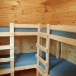 Two sets of bunk beds in each cabin