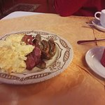 The warm breakfast: sausages, bacn and scrambled eggs