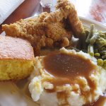 Corn bread, fried chicken, green beans and mashed potatoes