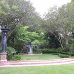 Central garden with fountain and statues.