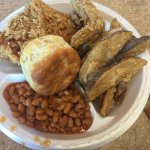 Spicy chicken, wedges and baked beans.