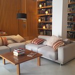 Small library and sitting area at the hotel entrance