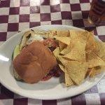 Mayan Chipotle Grilled Chicken Sandwich sliding off the bun