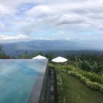 The hot tub is located at the end of the infinity pool- great views of the coast and mountains