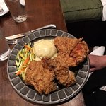 Southern fried chicken on pewter plate