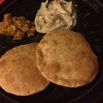 deepfried bread with chickpea curry and mushroom cream curry