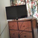 Big TV but dusty chest of drawers