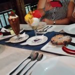 Left chocolate mud cake, tripple chocklate sundae, three flavours sorbet and right fruit pie, YU