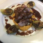 Duck breast over sweet potato puree with brussel sprouts