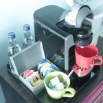 Coffee and tea making machine - at back two bottles of water