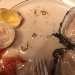 Live worms in raw oysters