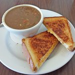 Beef soup with grilled ham and cheese
