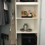 small closet with shelves, locked mini bar and no coffee machine