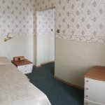 (fish-eye photo) single bed, bedsite table, chest of drawers, TV