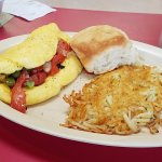 Fluffy western omelette made with fresh ingredients, hash brown and homemade biscuit...it was yu