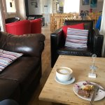 Inside the Tempest Cafe, tables and chairs or armchairs