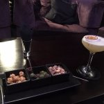 the bar with a passion fruit martini